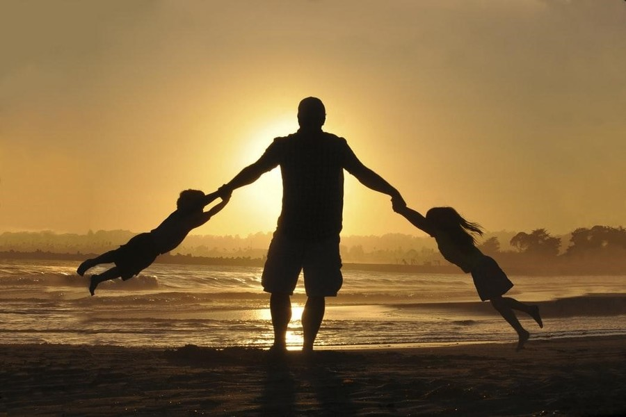 Man Swinging Kids Beach Sunset